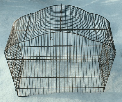 A real bird cage, meant to hold a finch or canary captive...
