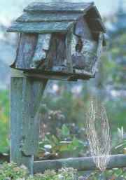 Barnboards transformed into bird houses