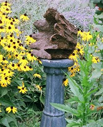 Pedestal with a hypertufa creation