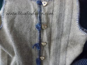 Hand Crafted Antler Buttons decorate a handwoven vest