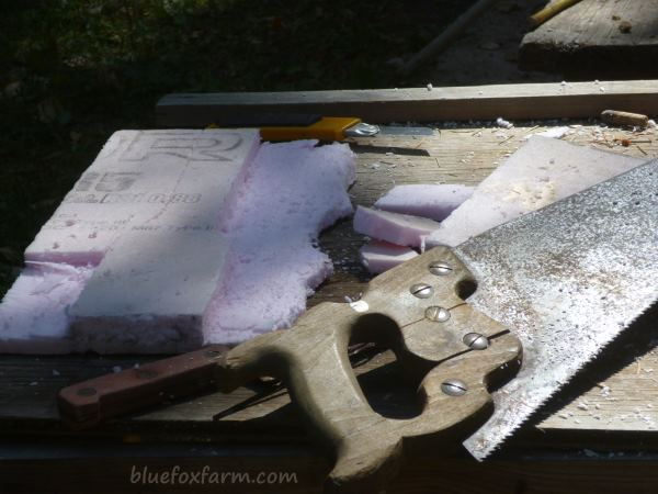 Cutting the rough shape of the chimney with a carpenters saw or serrated blade
