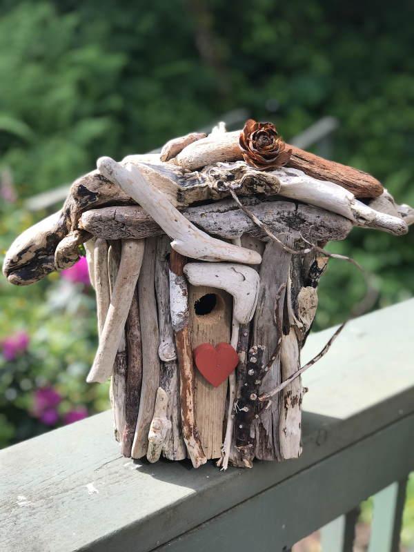 Driftwood embellished bird house