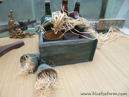 Twig handles are a fun way to decorate a plain green box...