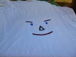 paint a scarecrow face on an old t-shirt