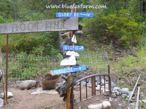 The cloud shape signs added to the sign post at Boot Hill