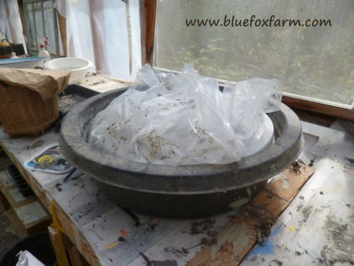 The mold lined with poly film for the hypertufa millstone