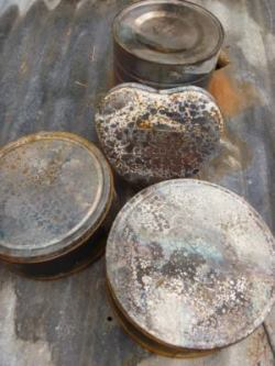 Give tin cans and decorative tins a rusty patina of age