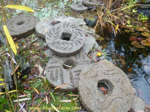Displayed by the pond, the Hypertufa Millstones
