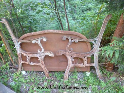 Rusty metal park bench parts