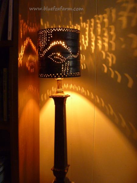 The effect of the way the light shines through a punched tin lampshade is magical