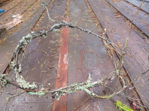 One twig, curved into a rough circle shape...