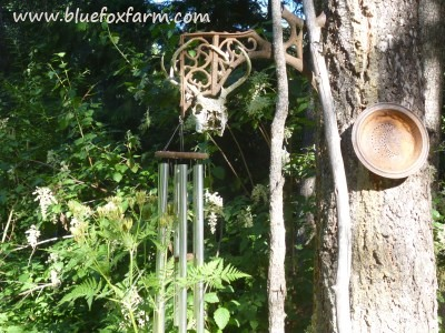 Cast metal school bench support makes a handy hanger for the wind chimes