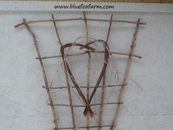 A twiggy heart decorates the Twig Fan Trellis - want one?  Look here...