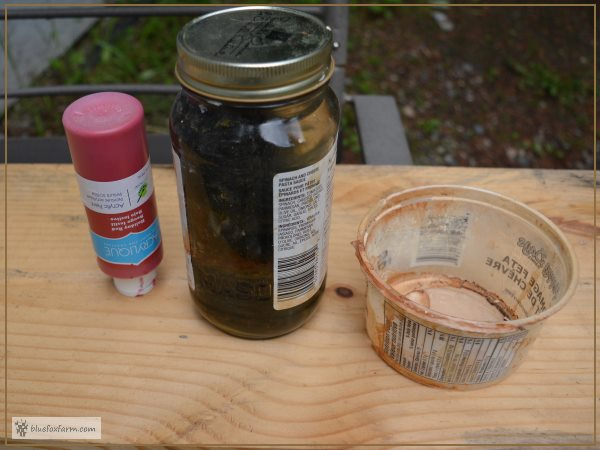 Supplies for making Weathered Red Barn Paint - Giggle Juice, Holiday Red Acrylic Craft Paint, a container and a paint brush, not shown.