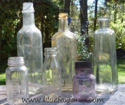 Antique Glass Bottles, some showing the amethyst color of extreme age