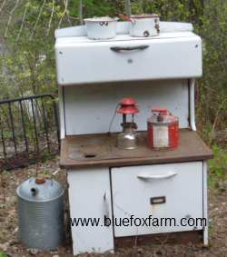 Antique Wood Cook Stove - see what it looks like now, as a display for some junk gardening vignettes...