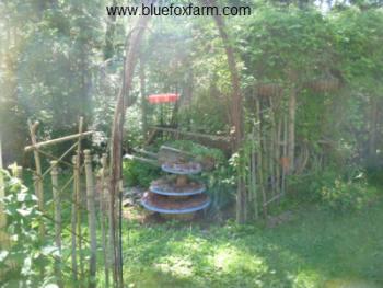 Twig Lattice Fence flanking a rustic garden arch