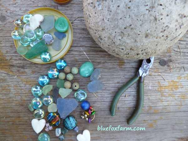 A collection of sea glass, marbles, beads and gems