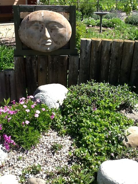 See the gravel garden with this moon face watching over...