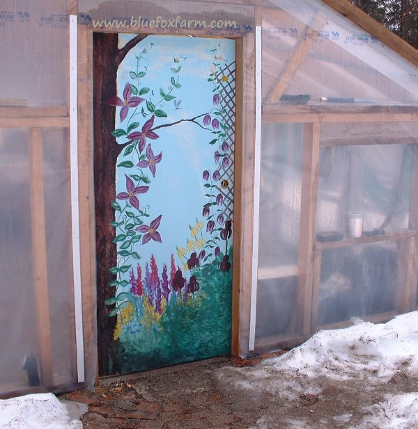 Greenhouse Door painted with flowers on a trellis