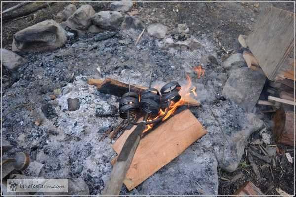 Burning off the finish on the Mason Jar Lids