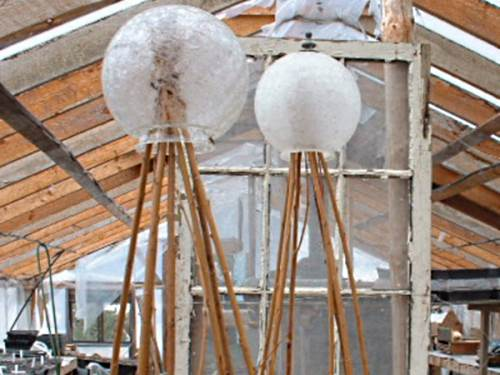 Glass globes from old light fixtures find their perfect use; as a finial