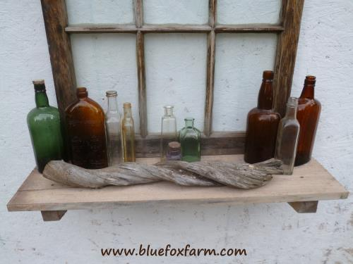Natural twisted driftwood accents the bottle collection