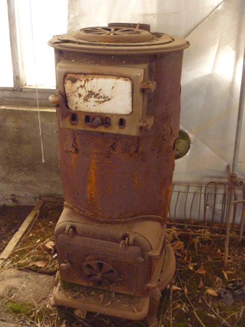 Really Rustic Wood Stove in a greenhouse