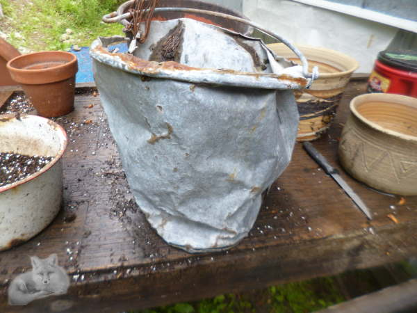 The side view of the old bucket