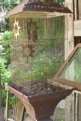 Cherub in a bird cage