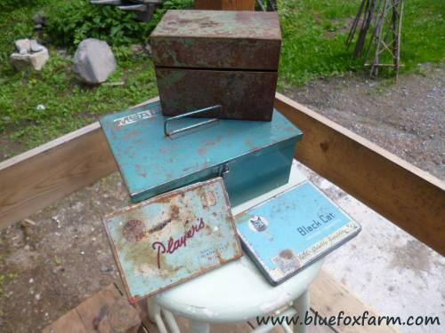 A collection of blue vintage tins